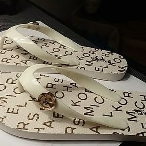 Authentic MK flip flops fits to 5 1/2